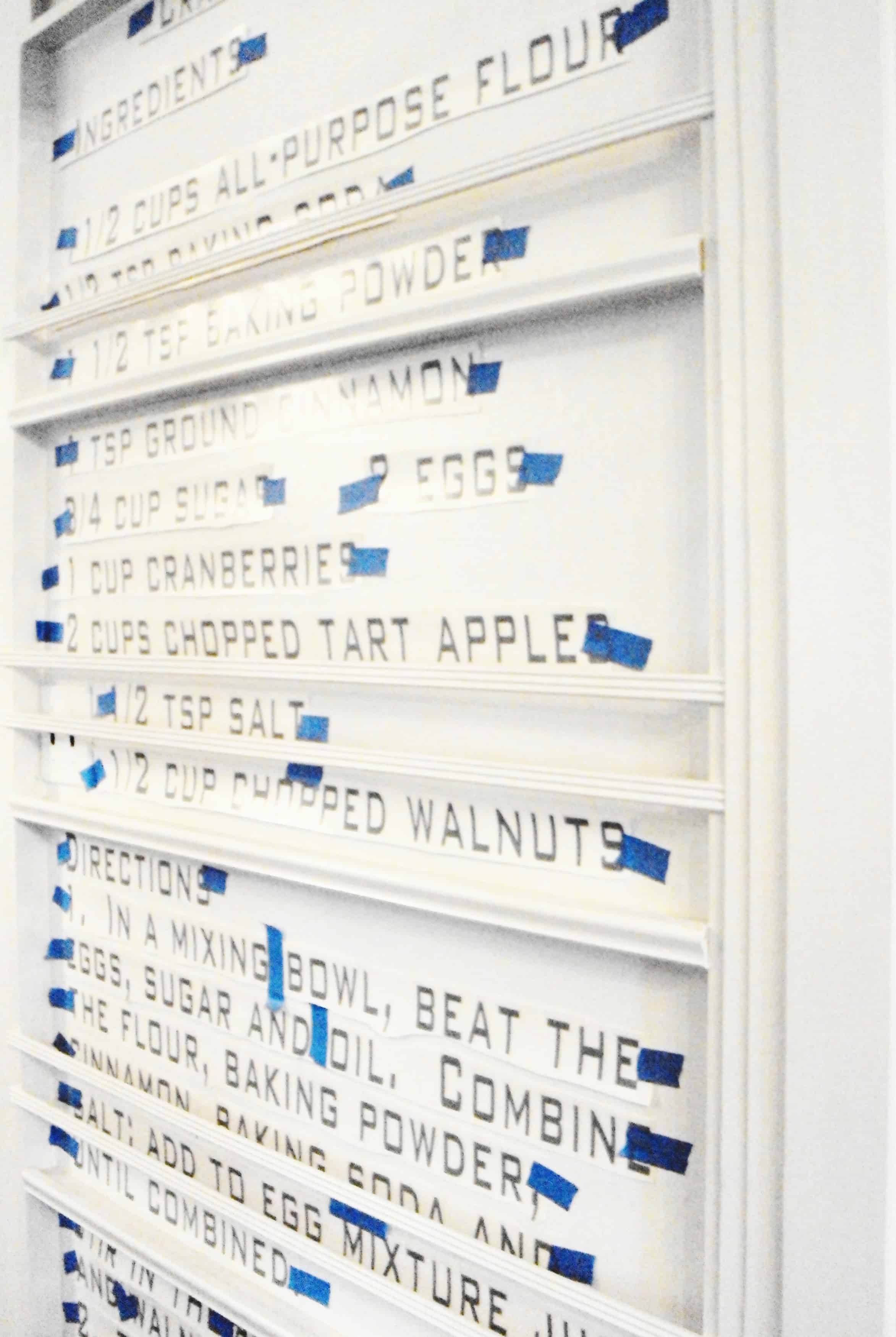 Attach the vinyl for your recipe wall and adhere with painter's tape.