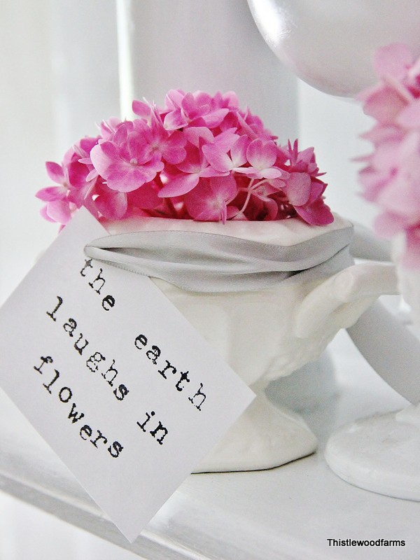 This adorable quote attached to the vase of hydrangeas is cute decor.