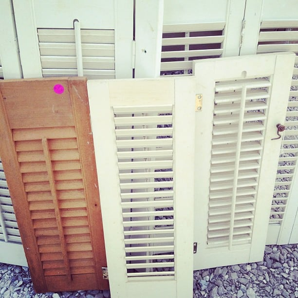 Pick up all the shutters you can at yard sales and antique stores