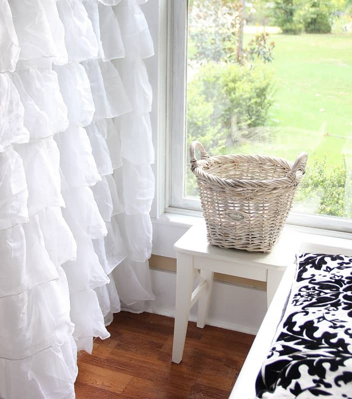 Basket with a ruffled shower curtain
