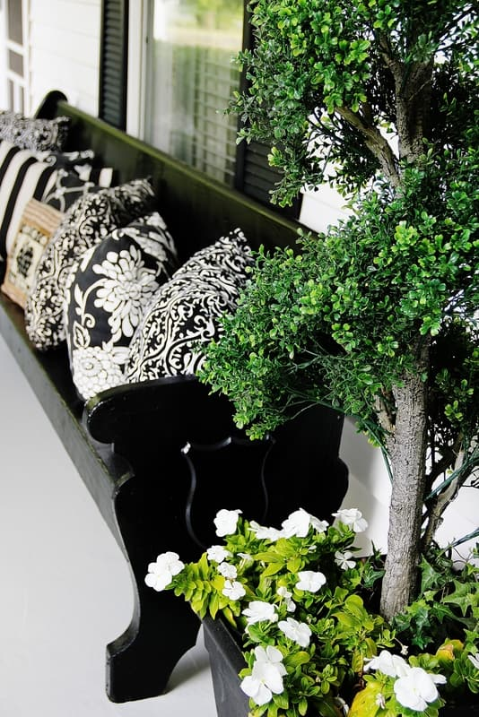 Elegant black bench and pillows on the front porch