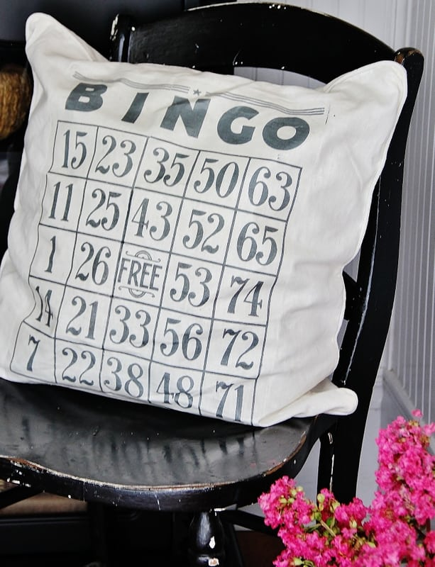 Bingo card pillow in chair