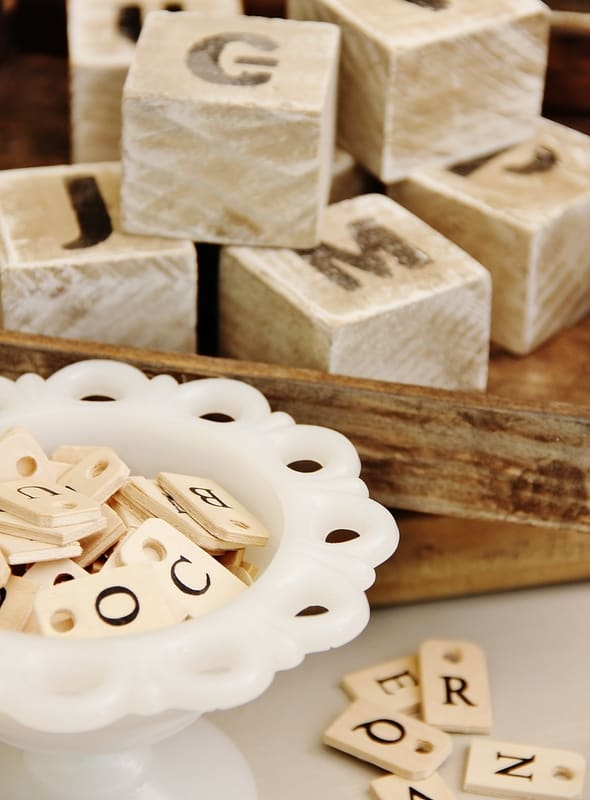 scrabble letters with wooden blocks