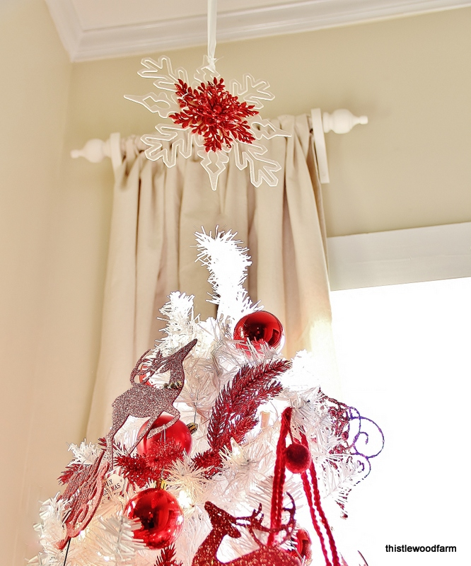 This red and white snowflake is the perfect topper for the Christmas tree.