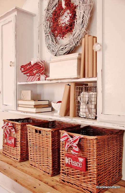 This Christmas desk with holiday ribbons and a red and white wreath add festive elements to the room.