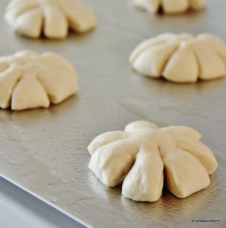 Slice the edges of the dinner rolls