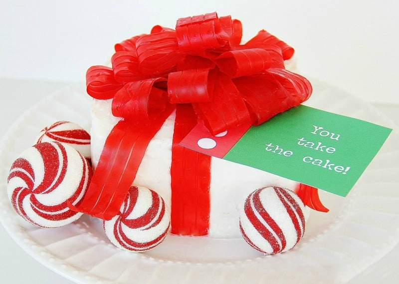 Present cake with fruit roll up ribbon