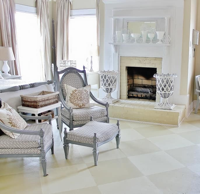 This chic painted plywood floor compliments the neutral decor and accent pillows.