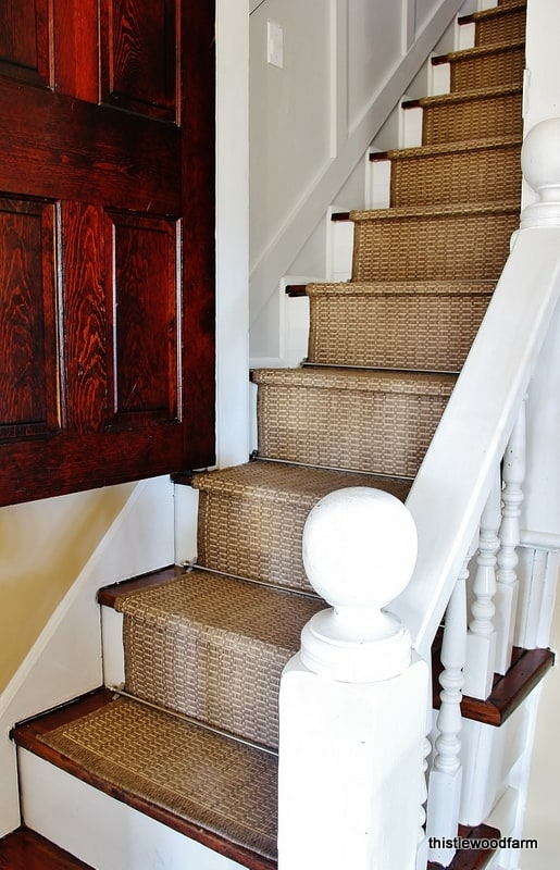 This DIY stair runner will be perfect for your home, easy to make and holds up to wear and tear.