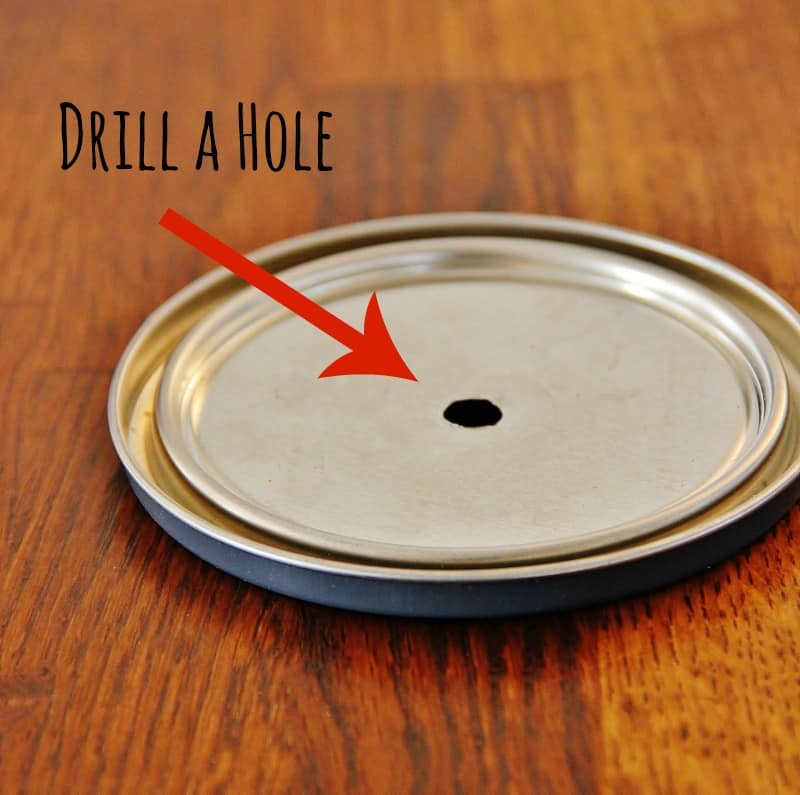 Drill a hole in the center of a paint can lid for your bicycle wheel clock.