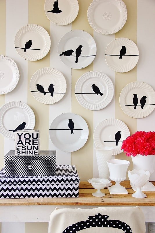 living room wall idea created from bird plates with bird decals on them