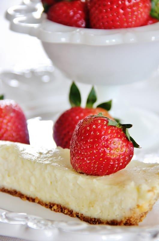 Fresh strawberries pair well with this lemon zest cheesecake.
