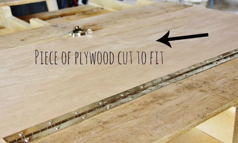 Cut a piece of plywood to fit into the fold up pallet desk.