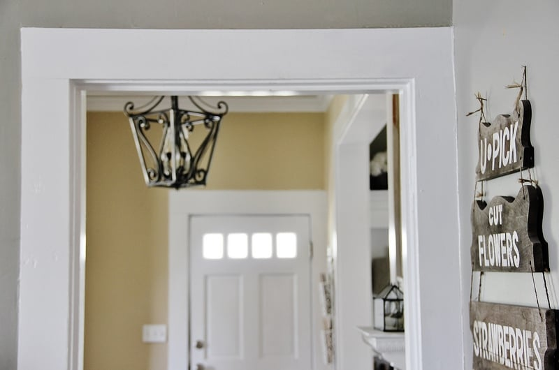 DIY door molding we installed ourselves - white trim along a gray painted wall
