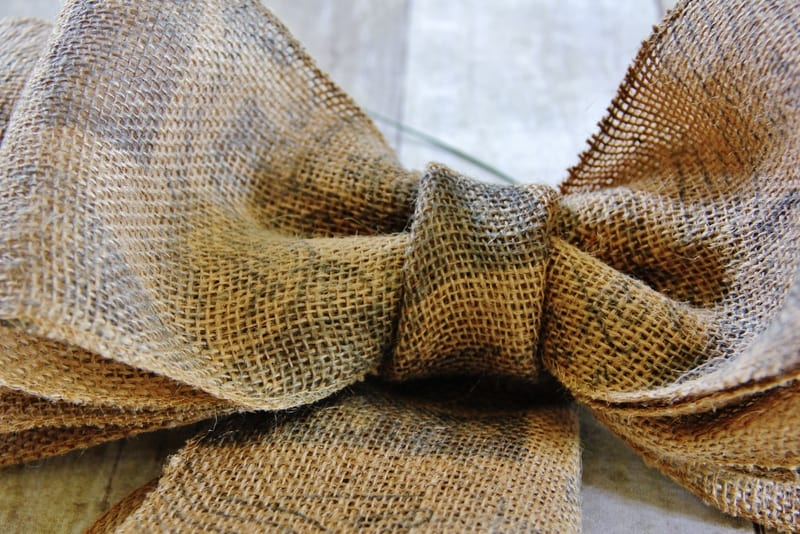 burlap ribbon wrapped with burlap ribbon in the center of the bow