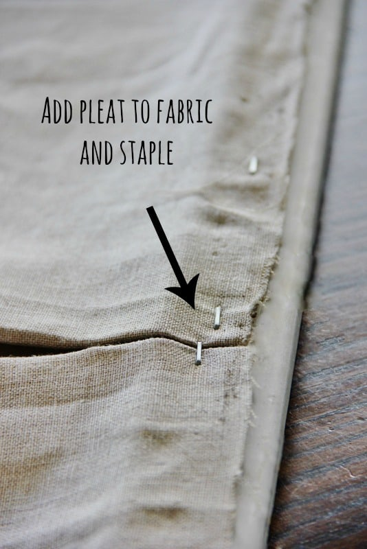 Then, you'll add a pleat to your fabric and staple into place.