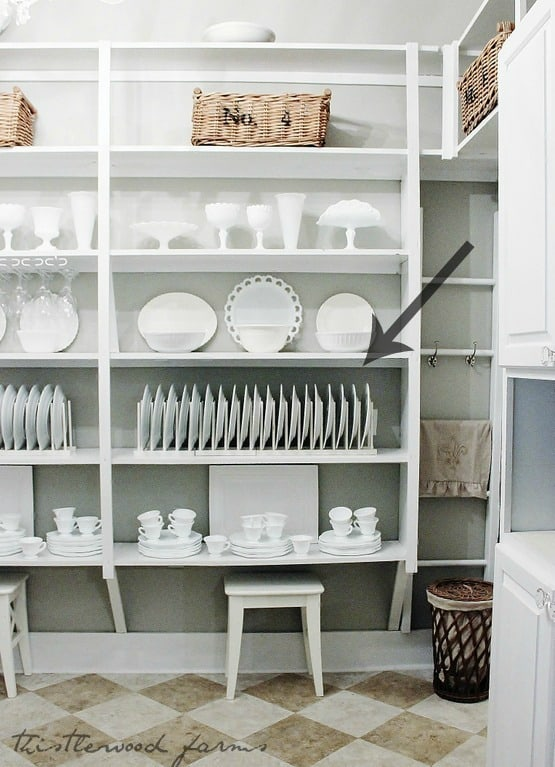 This simple plate display rack in the butler's pantry helps maintain organization.