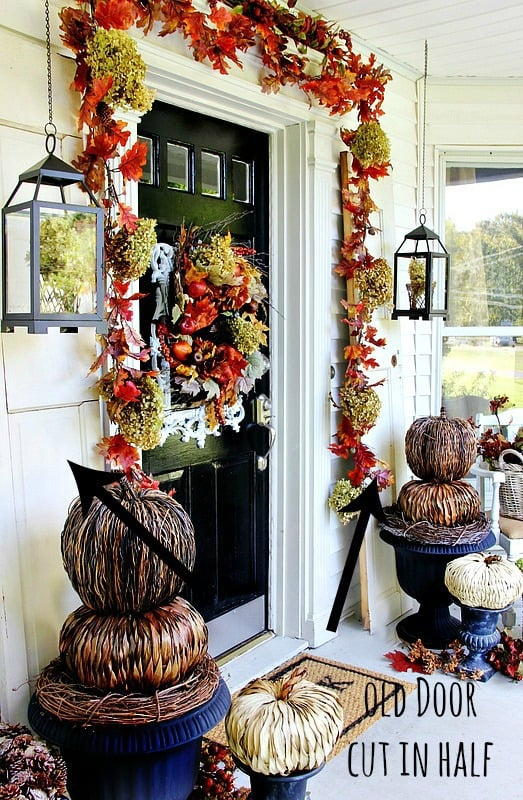 Old doors on either side of your front door add rustic and fall elements to your home.