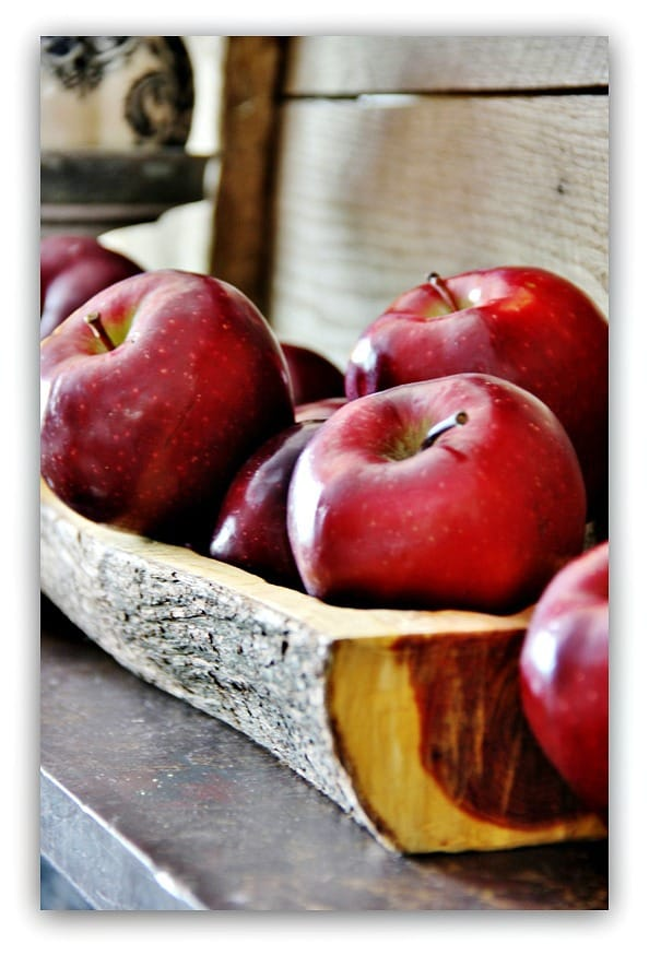 Nothing says fall like some fresh red apples on a piece of cut wood.