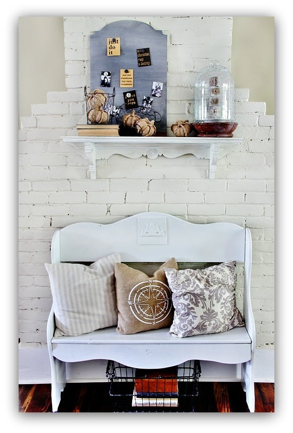 These decorative throw pillows compliment the white bench.