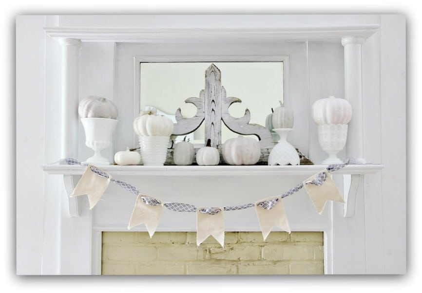 This fall mantel featuring white mini pumpkins and white brick is beautiful.