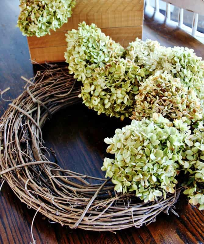 Continue the step of wrapping the wire and hydrangea all the way around your wreath.