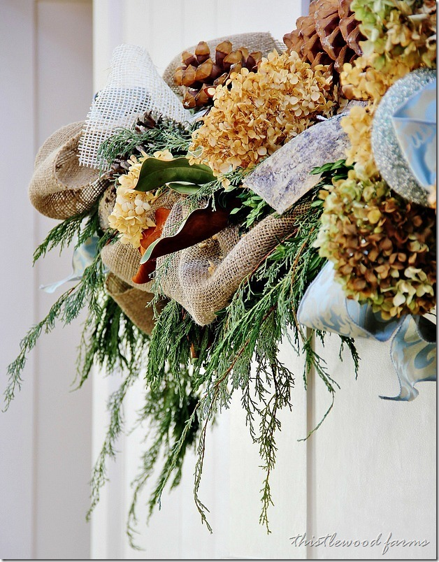 Decorative fern wreath with burlap ribbons and dried hydrangea flowers