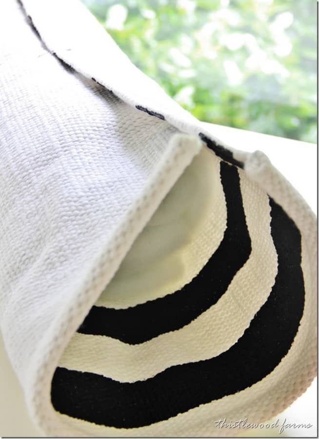 Wrap the rug around the pillow form and secure with safety pins