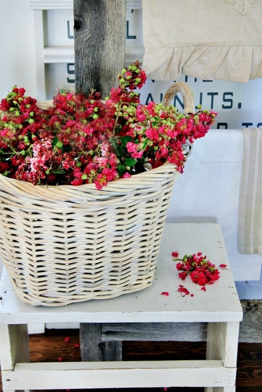 This barn wood mini table is perfect for baskets filled with fresh flowers.