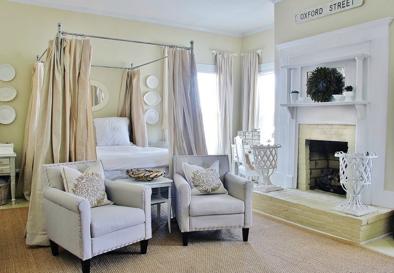 The neutral tones in this master bedroom compliment the white fireplace.