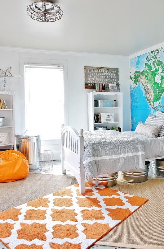 This colorful orange rug adds interest to this guest room.