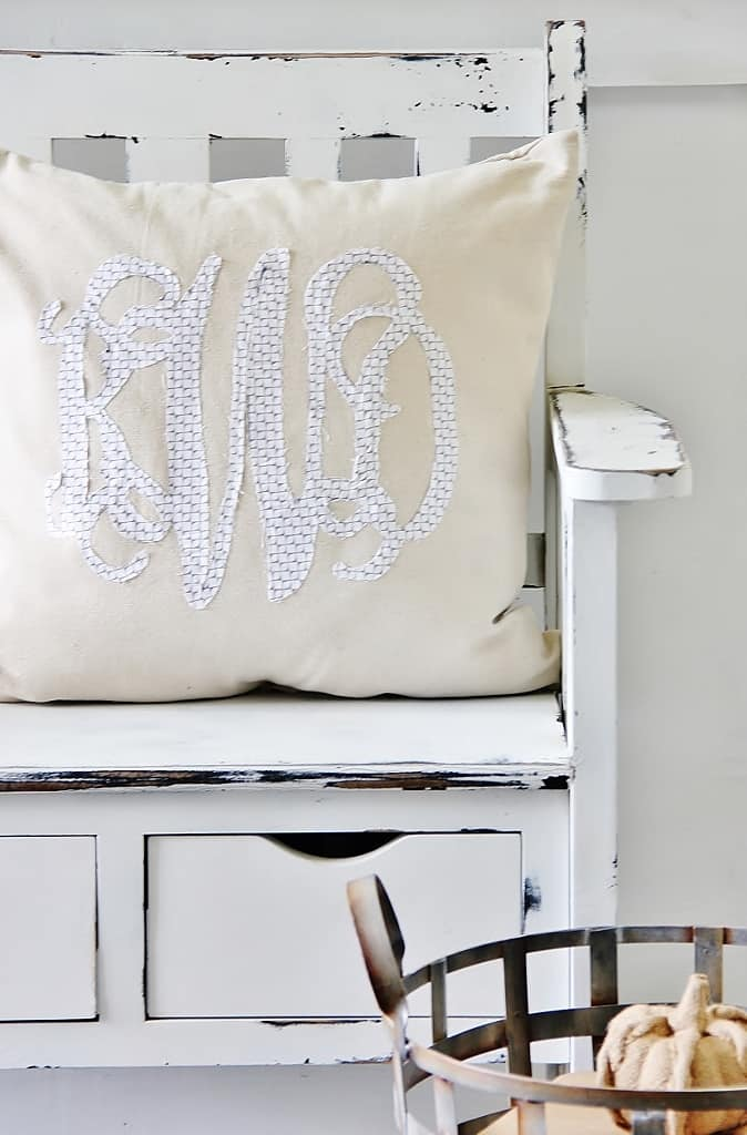 Display the finished monogram pillow on a vintage bench like this one.