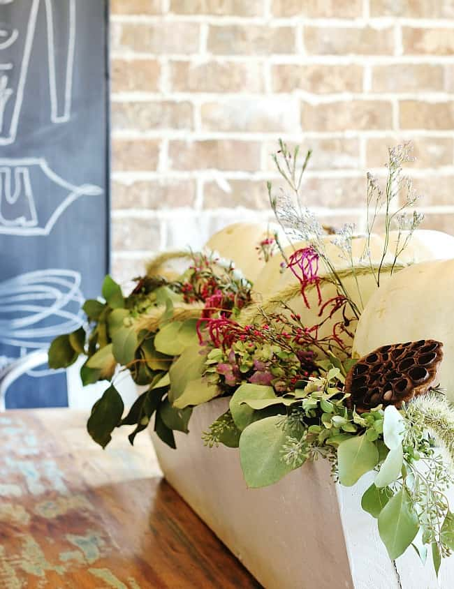 Make a centerpiece by filling a large over-sized container with greenery from your yard.