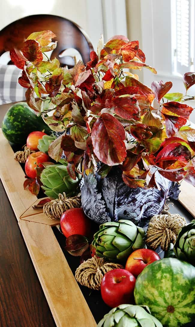 Use cabbages as vases then fill with foliage to create a rustic centerpiece.