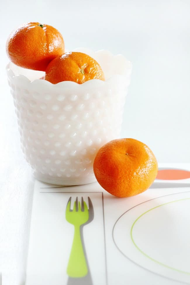 oranges and milk glass