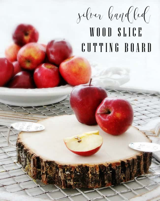 silver handled wood slice cutting board