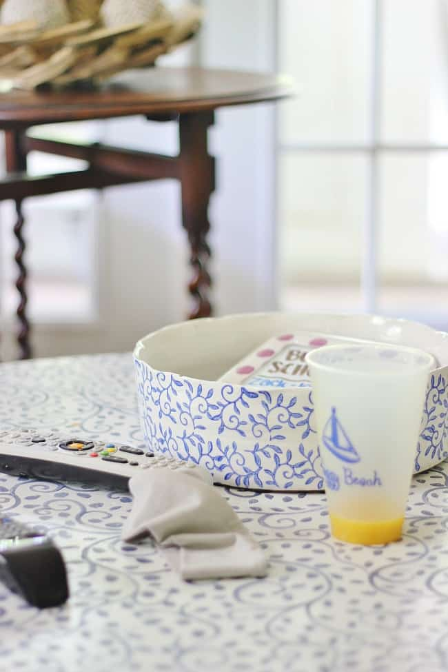 Remote controls, head bands and cups are a few of the items that clutter up a coffee table.