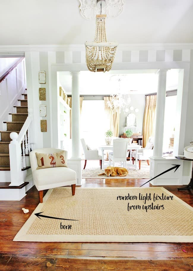 No home is perfect, this dining room has a dog bone on the ground and a messy entry table.
