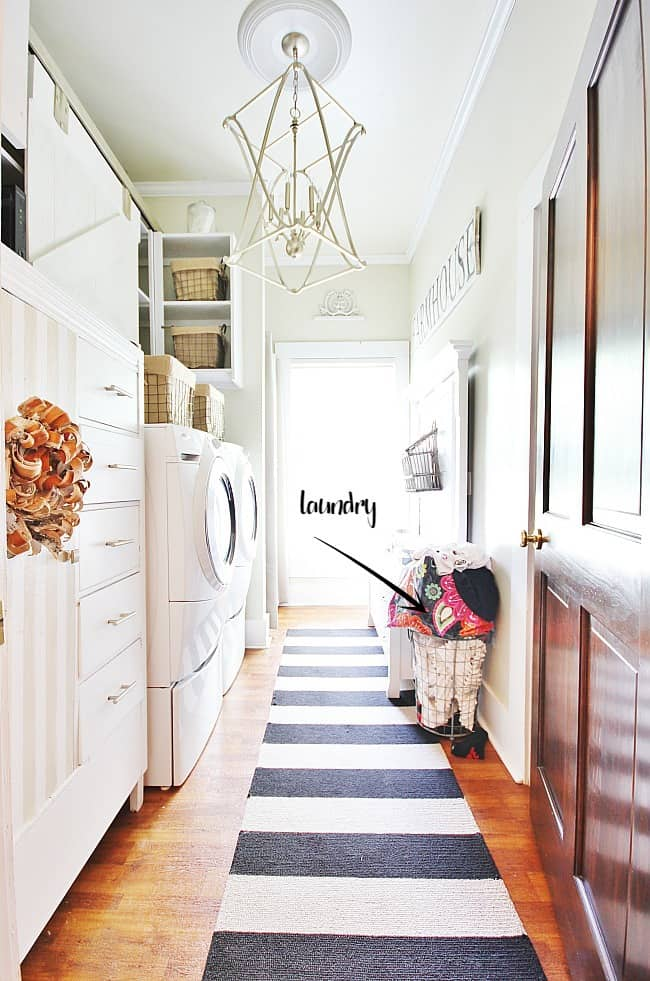 This quaint laundry room has piles of dirty clothes that need attention.