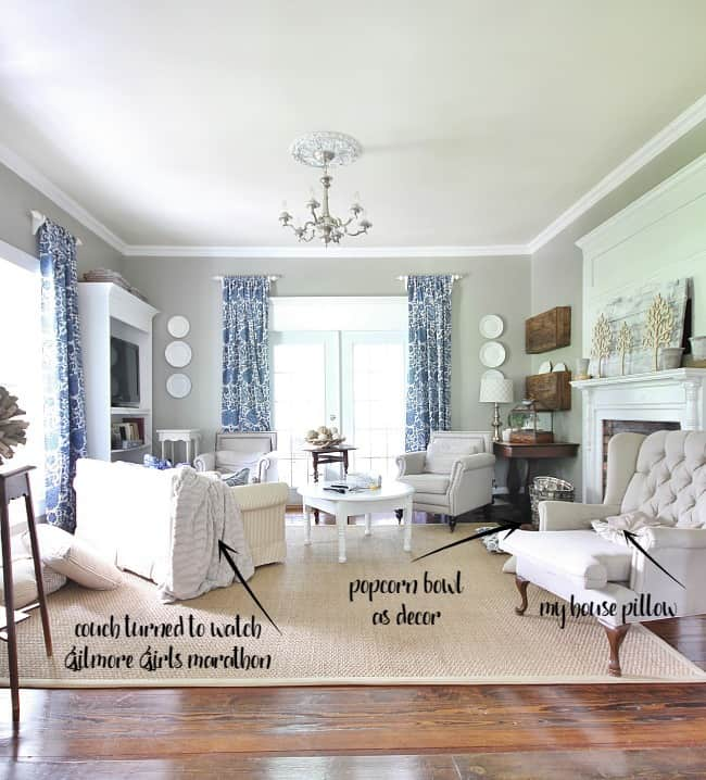 Sometimes living rooms like this one get messy with dirty dishes and crumpled up pillows.