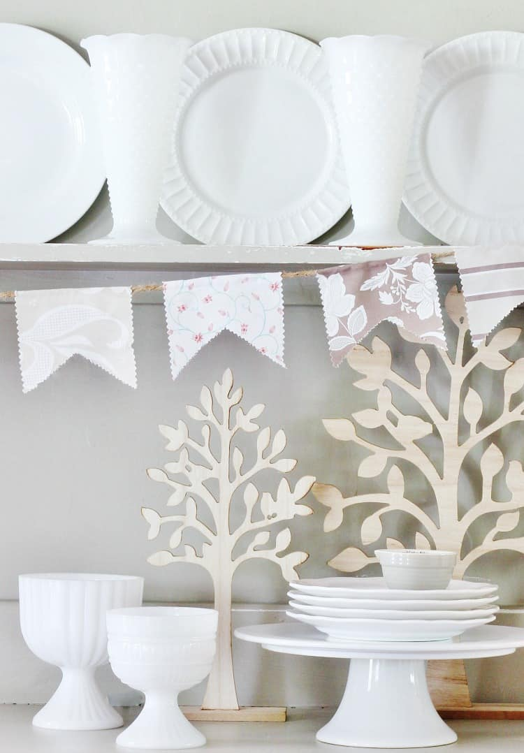 This fabric pennant banner was made with a charm pack of simple patterned fabrics