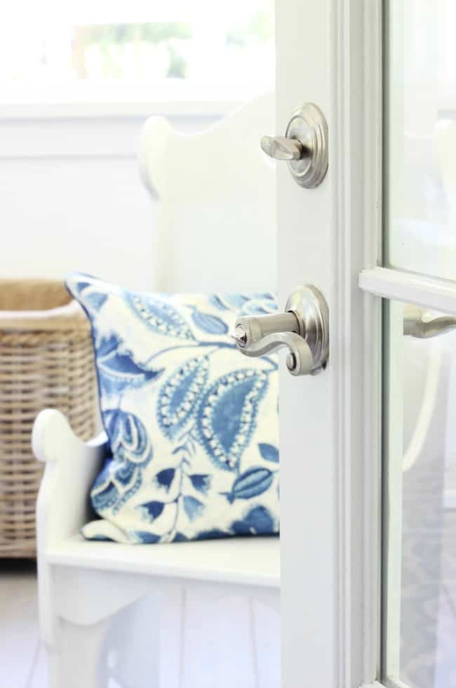 french door and blue pillow