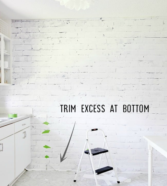 Then, trim away any excess at the bottom of the wall