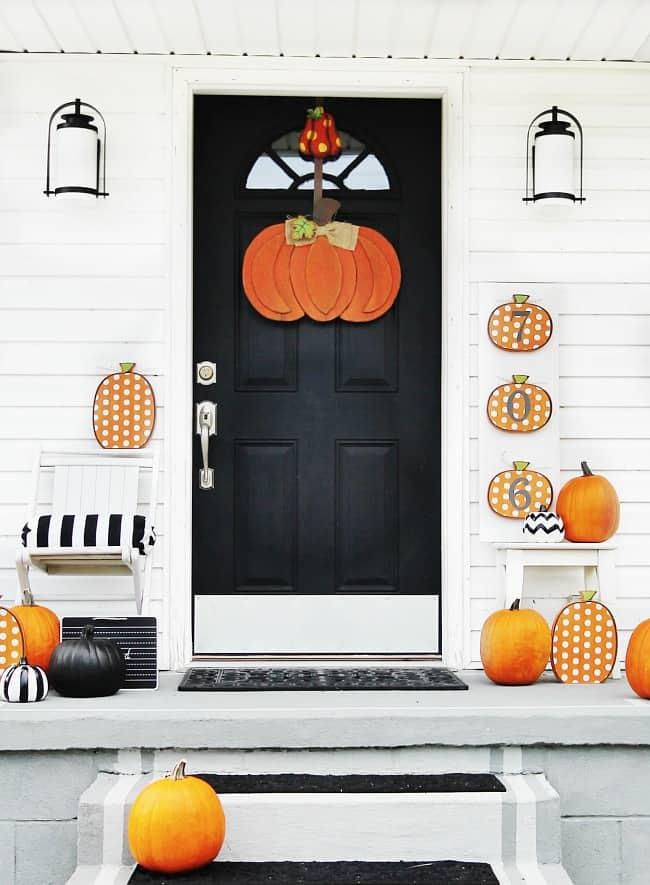 fall front door decorating with pumpkins