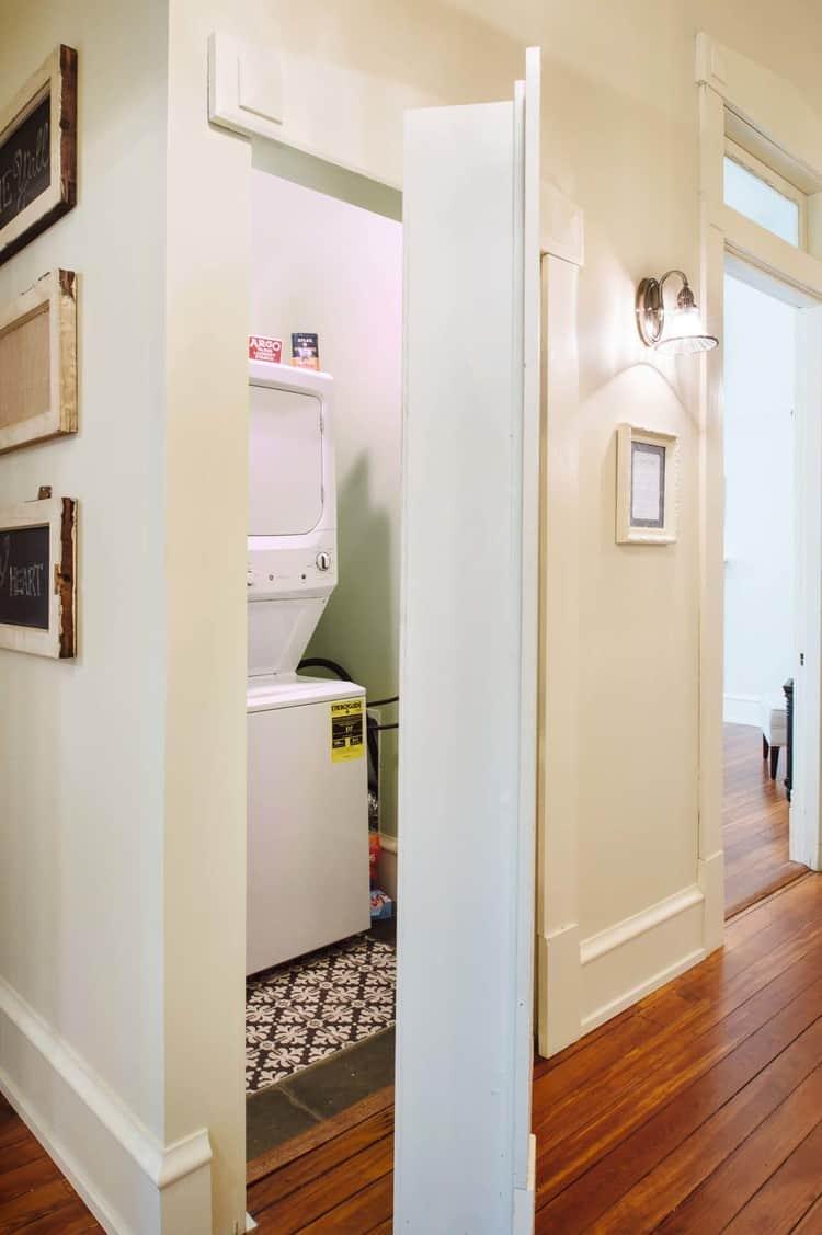 Hall bookcase hides laundry unit