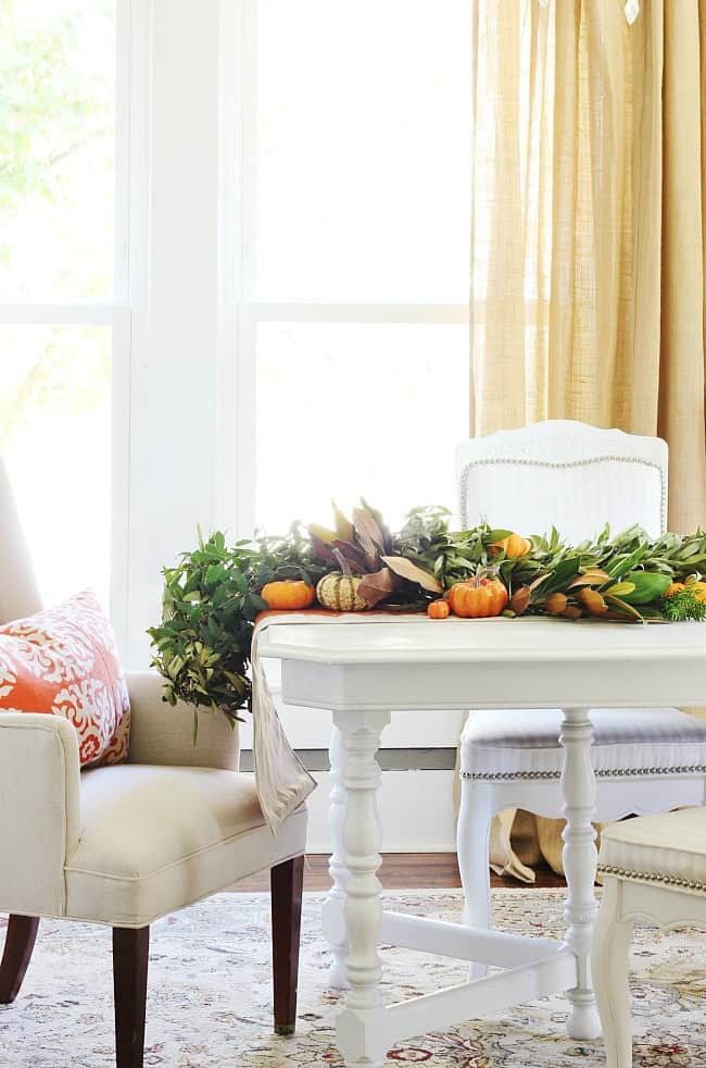 Use garland as your centerpiece adding in pumpkins, fruit and vegetables to brighten it up.