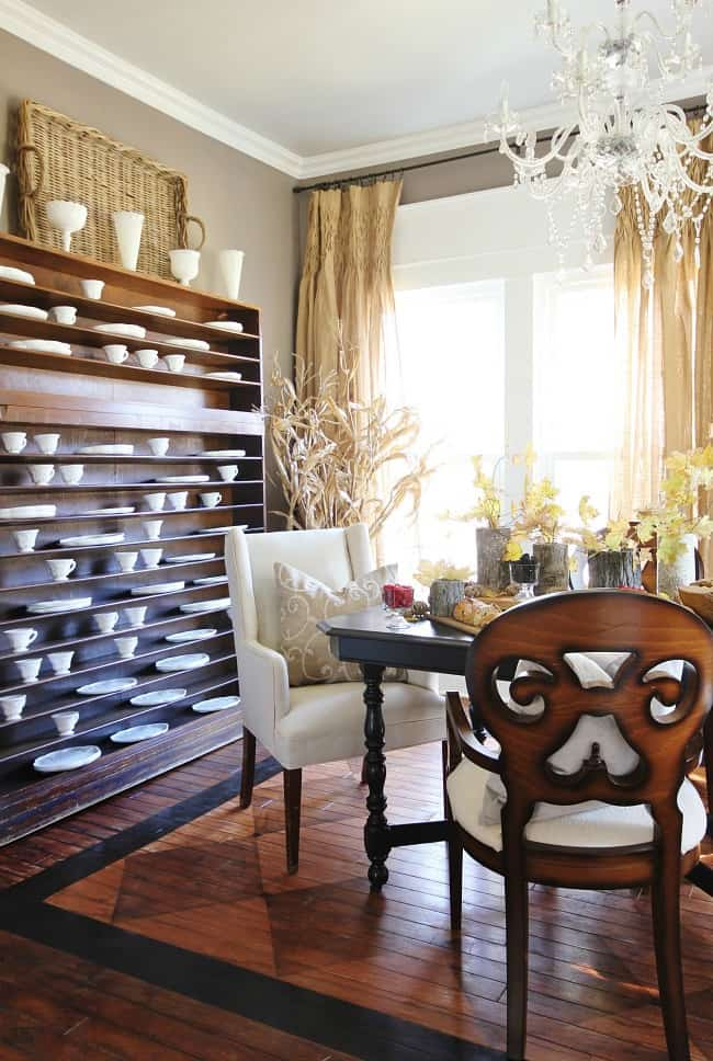 The square design on the wood floors adds character to the entire farmhouse dining room.