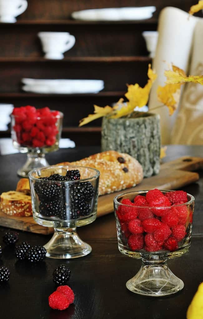 This beautifully stained dark coffee table is great for serving fresh fruit and breads.