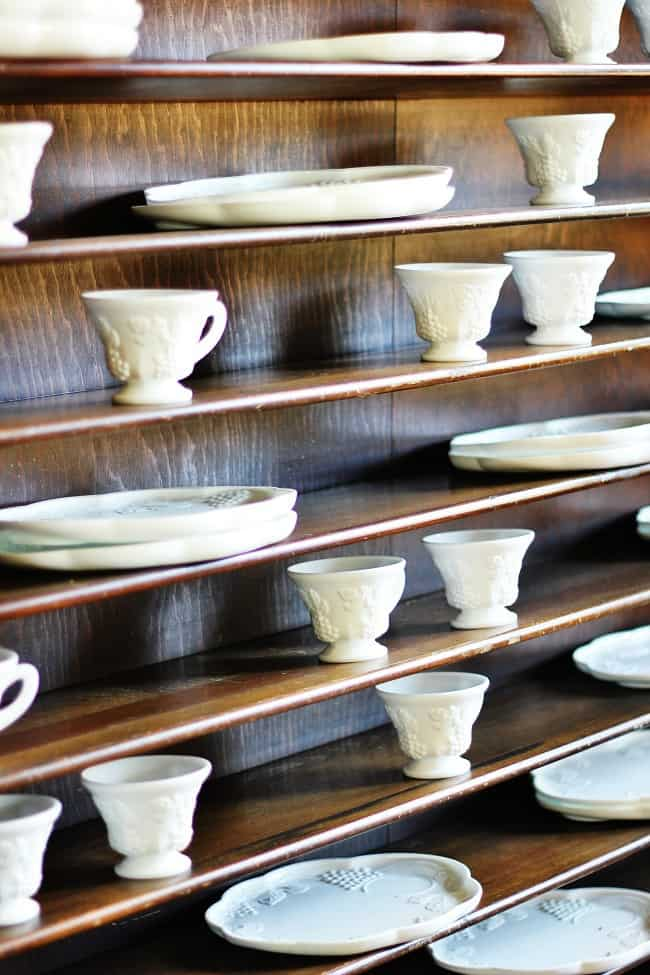 These classic shelves for plates and tea cups pair well with the rooms decor.