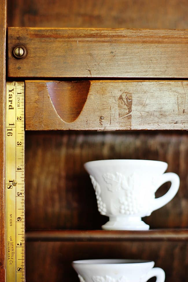 These wood shelves are from the 1800s and perfect for storing tea cups.